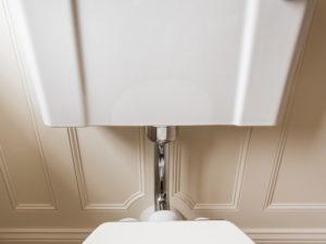 Elegant Panelled Bathroom Panelling around Pipework
