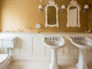 Elegant Panelled Bathroom showing Glass Shelf over Panelling