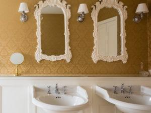 Elegant Panelled Bathroon with Twin Vanity Sinks Hand Painted Mirrors