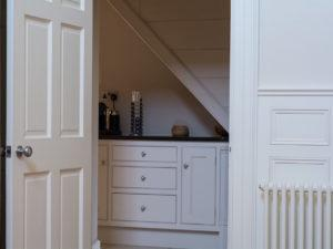 Hall Panelling with understairs cupboards behind